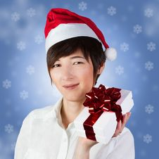 Woman In Santa Hat With Gift Box Royalty Free Stock Photo