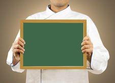Free Chef Showing Chalkboard Stock Photo - 27998030