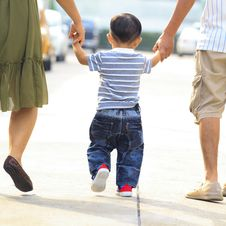 Free Parents Holding Hand Of His Son Stock Images - 27999234
