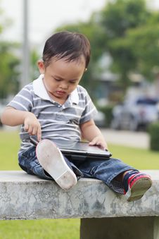 Little Boy Using A Tablet Stock Photo