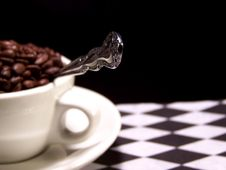 Silver Spoon With Coffee Beans Stock Images