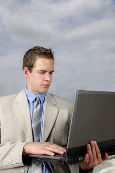 Free Young Businessman With Laptop Royalty Free Stock Images - 2804059