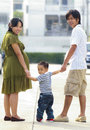 Free Parents Holding Hand Of His Son Stock Image - 28000451