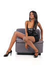 Free Young Black American Woman Sitting On A Couch Stock Image - 28012091