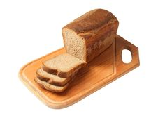 Brown Bread On A Cutting Board Stock Photography