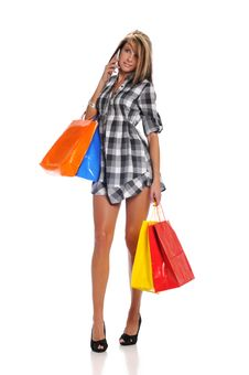 Free Young Woman With Shopping Bags And Cell Phone Royalty Free Stock Images - 28012209