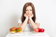 Free Woman Sitting Behind The Table With Food Royalty Free Stock Photos - 28020188
