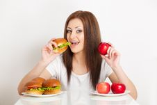 Free Woman Sitting Behind The Table With Food Royalty Free Stock Photos - 28020198