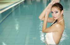 Beautiful Young Woman Standing In A Swimming Pool Royalty Free Stock Image
