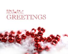 Red Christmas Beads And Snow Stock Image