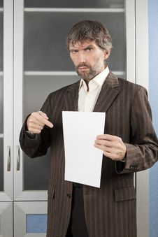 Free Angry Man Shows Blanc Sheet Of Paper Stock Photo - 28038490