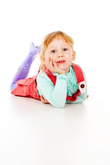 Free A Little Girl In A Red Dress, Lying Posing Royalty Free Stock Photo - 28042865