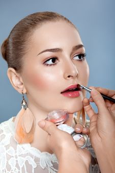 Woman With Brush For Professional Make-up Royalty Free Stock Photography