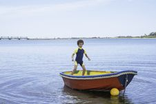 Free Boy Rocking Small Boat Stock Photography - 28054152