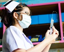 Nurse With Medical Syringe Stock Photo