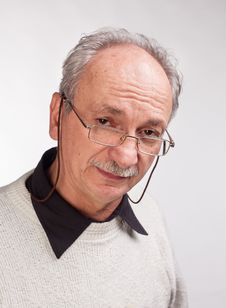 Free Mature Man With Glasses And A White Sweater Stock Image - 28061761
