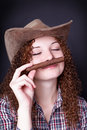 Free Pretty Redhead Girl Smelling Cigar Royalty Free Stock Image - 28076986