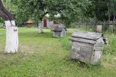 Free Lawn With Old Beehives Royalty Free Stock Photo - 28072655