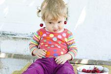 Little Girl With A Cherry Stock Photos