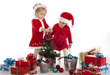 Free Two Happy Santa Helpers Royalty Free Stock Photography - 28094087