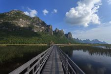 The Wooden Bridge In Lotus Lake In Thailand Royalty Free Stock Images