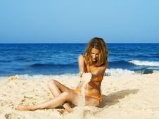 Woman Playing With Sand