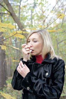 Free Woman Relieving Asthmatic Attack Using Inhaler Stock Photography - 28111292
