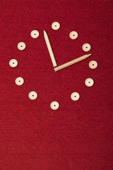 Simple Hand Made Clock On Red Background Stock Photography