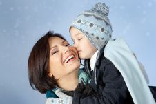Happy Mother And Son In Winter Clothes Stock Photo