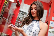 Free Attractive Young Woman Buying A Bracelet At A Jewelry Royalty Free Stock Images - 28128279
