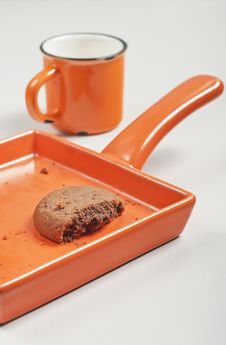 Free Broken Biscuit And Orange Cup Royalty Free Stock Photography - 28132747