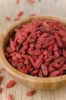 Wooden Bowl With Goji Berries Closeup Stock Image