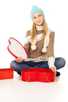Free Girl In Winter Hat Sitting With Gift Boxes Royalty Free Stock Image - 28137746