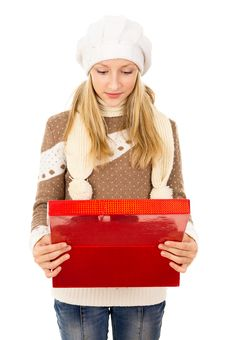 Free Girl In Winter Cap Holding A Gift Royalty Free Stock Photo - 28138375
