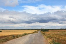 Free Storm Clouds Over The Road Stock Photography - 28138802