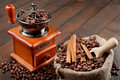 Free Coffee Grinder And Sack With Coffee Beans Stock Image - 28148471