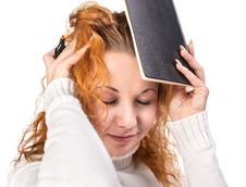 Free Education - Girl Holds A Notebook On Her Head Royalty Free Stock Photo - 28147675