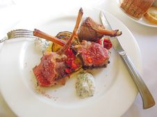 Lamb Chops On A Bed Of Vegetables Royalty Free Stock Photo