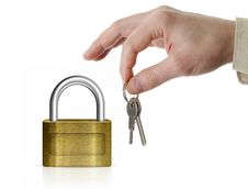 Closed Lock With Man S Hand And Keys Royalty Free Stock Image