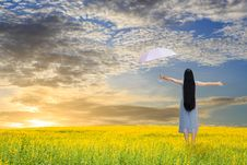 Free Asian Girl Holding Pink Umbrella In Grass Field Stock Photo - 28152320