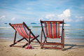 Free Two Bright Sun Loungers On The Beach. Stock Photos - 28169833