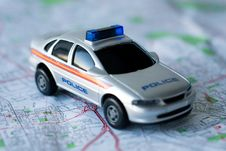 Police Car On A Map Stock Photo