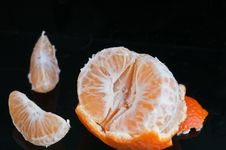 Free Half Peeled Tangerine With Rind And Two Slices Royalty Free Stock Image - 28165226