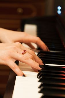 Girls Hands Playing The Piano Stock Images