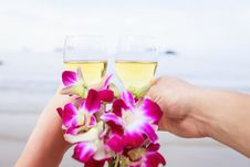 Free Two Hands, Glasses Of Champagne And A Bouquet Of Orchids. Stock Photo - 28169900