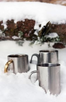Three Thermos Cups In The Snow On Winter Day Stock Image