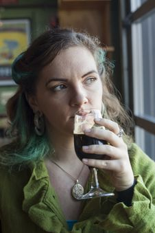 Young Woman Drinking Beer Stock Photos