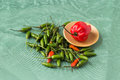 Free Red Perrer With Small Green Peppers Around Stock Image - 28190571