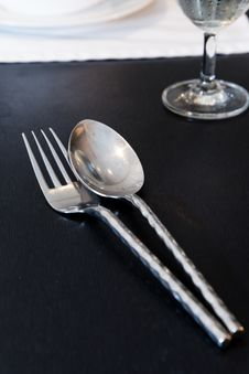 Free Silverware On Black Table Royalty Free Stock Photography - 28195747