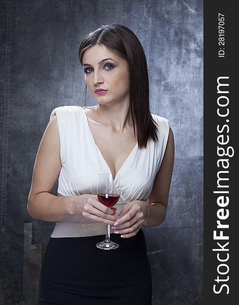 Female tasting wine